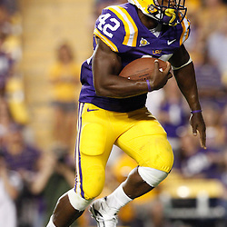 September 10, 2011; Baton Rouge, LA, USA;  LSU Tigers running back Michael Ford (42) carries against the Northwestern State Demons during the second half at Tiger Stadium. LSU defeat Northwestern State 49-3. Mandatory Credit: Derick E. Hingle