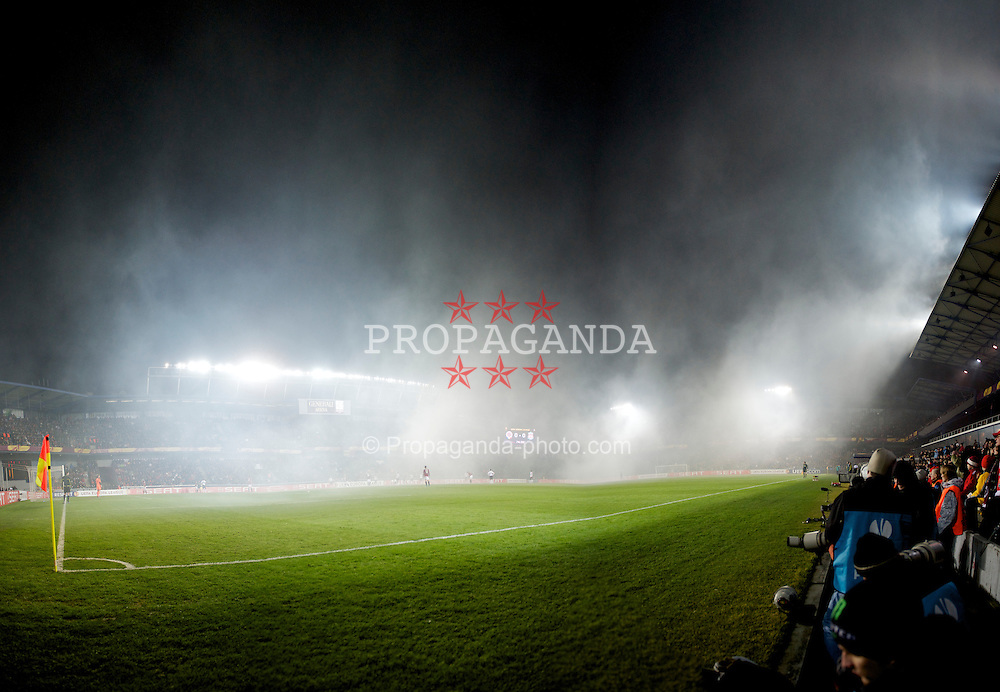 PRAGUE, CZECH REPUBLIC, Thursday, February 17, 2011: Smoke engulfs the stadium during the UEFA Europa League Round of 32 1st leg match between AC Sparta Prague and Liverpool at the Letna? Stadion . (Photo by David Rawcliffe/Propaganda)