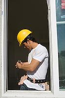 Construction Worker choosing equipment