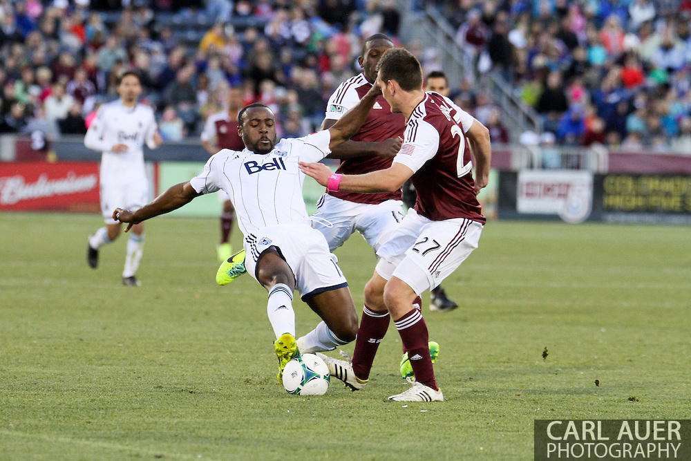 October 19th, 2013:  Colorado Rapids midfielder Shane O'Neill (27) stops a attack on goal by Vancouver Whitecaps FC midfielder Nigel Reo-Coker (13) in the second half of the MLS Soccer Match between the Vancouver Whitecaps FC and the Colorado Rapids at Dick's Sporting Goods Park in Commerce City, Colorado