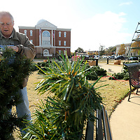 Boyd Yarbrough sorts through pieces of the Christmas Tree top getting the lights ready before putting the all pieces together and installing them on the tree frame Tuesday morning in Fairpark in Tupelo.