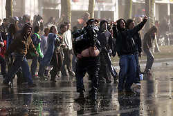 Demonstrators protested against the war in Iraq in front of the U.S. Embassy in Brussels, Belgium, on Friday March 21, 2003. Police used water canons to break up the demonstration when a handful of protesters started throwing bottles and rocks. (Photo © Jock Fistick)