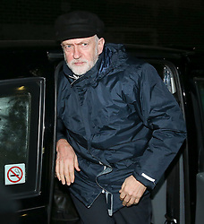 © Licensed to London News Pictures. 11/12/2015. London, UK. Labour party leader Jeremy Corbyn drives through a back door to attend a Stop the War Coalition fundraising dinner at the EV restaurant. Photo credit: Peter Macdiarmid/LNP