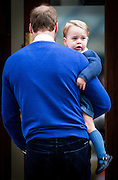 UNITED KINGDOM, London: 2 May 2015 Prince William, Duke of Cambridge arrives back st the Lindo Wing with his son Prince George of Cambridge so that he can meet his sister, Princess Charlotte, for the first time at St Marys Hospital in London, England.  Andrew Cowie / Story Picture Agency
