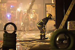 © Licensed to London News Pictures . 25/12/2017. Manchester, UK. At least eight fire engines, teams of firefighters, police and ambulance crews are responding to a fire, which was first reported just after 1am on Christmas day morning, on an industrial unit in Cheetham Hill , off Cheetham Hill Road, in Salford on the edge of Manchester City Centre . Photo credit: Joel Goodman/LNP