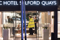© Licensed to London News Pictures. 10/08/2017. Salford, UK. Police and bystanders in the foyer of the Marriott Hotel which is next door to and shares a car park with the Ibis Hotel .  The scene at the Ibis hotel in Salford Quays where a young boy was killed in a collision with a car earlier this evening (Thursday 10th August 2017) . Photo credit: Joel Goodman/LNP
