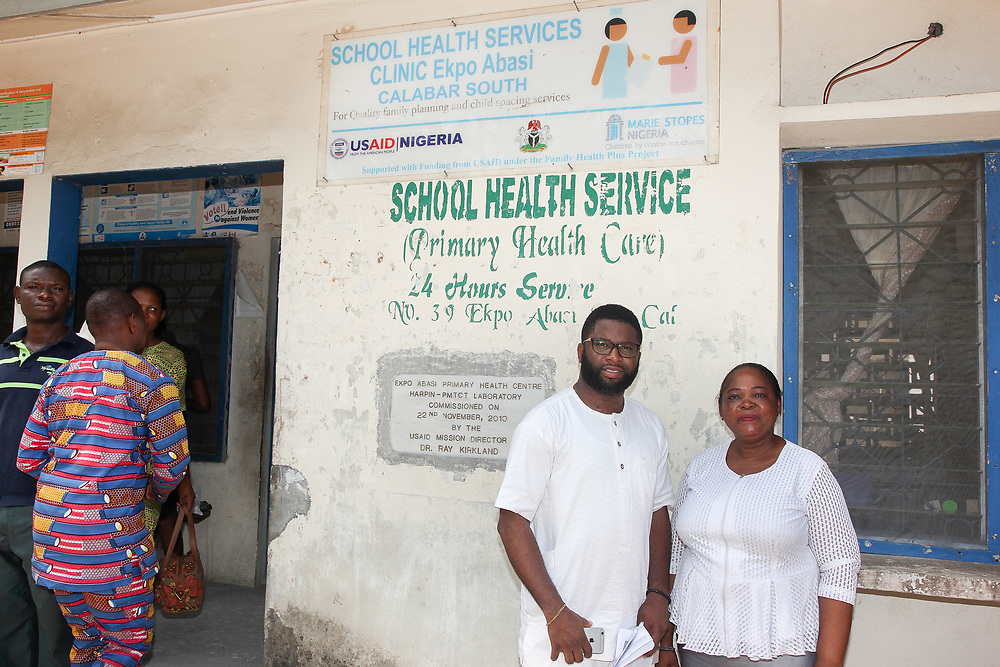 INDIVIDUAL(S) PHOTOGRAPHED: From left to right: Unknown, N/A, Somto Mbelu, and Bridget Agede. LOCATION: Epko Abasi Clinic, Calabar, Cross River, Nigeria. CAPTION: Somto Mbelu, HFG's Knowledge Management and Communication Specialist, and the Director of Epko Abasi Clinic, pose in front of the clinic's collection point in Calabar in the Nigerian state of Cross River.