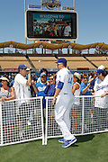 LOS ANGELES, CA - JUNE 30:  Aaron Harang #44 of the Los Angeles Dodgers greets fans at fan photo day before the game against the New York Mets on Saturday, June 30, 2012 at Dodger Stadium in Los Angeles, California. The Mets won the game in a 5-0 shutout. (Photo by Paul Spinelli/MLB Photos via Getty Images) *** Local Caption *** Aaron Harang