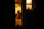 Kemen draws inside the hut, as there is no light outside. Brontallo (Switterland) July 02, 2014. Beñat and Nathalie spend two months (July and August) on Spulüi, at 1.900 meters, taking care of goats and making cheese. Their children Kemen (7 years old) and Oihu (18 months) are with them. (Gari Garaialde / Bostok Photo)