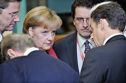 "Angela Merkel, Germany's chancellor, left, speaks with Nicolas Sarkozy, France's president, during the European Union Summit at the EU headquarters in Brussels, Belgium, on Friday, Oct. 30, 2009. European Union leaders are set for ""very difficult"" talks to overcome the Czech Republic's resistance to a new governing treaty designed to strengthen the EU's influence in world affairs, Reinfeldt said. (Photo © Jock Fistick)"