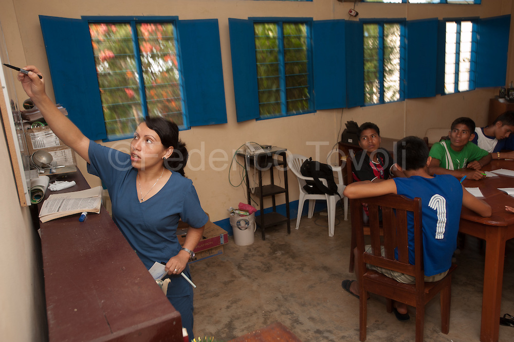 Dr. Mary teaching at the pre-university course in the same Health Center of Santa Clotilde