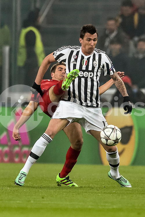 Philipp Lahm of Bayern Munchen challenges Mario Mandzukic   of Juventus  during the UEFA Champions League match Round of 16 between Juventus and Bayern Munich at the Juventus Stadium, Turin, Italy on 23 February 2016. Photo by Giuseppe Maffia.