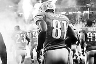 Detroit Lions wide receiver Calvin Johnson (81) runs onto the field before the first half of an NFL football game against the Minnesota Vikings, Sunday, Oct. 25, 2015, in Detroit. (AP Photo/Rick Osentoski)