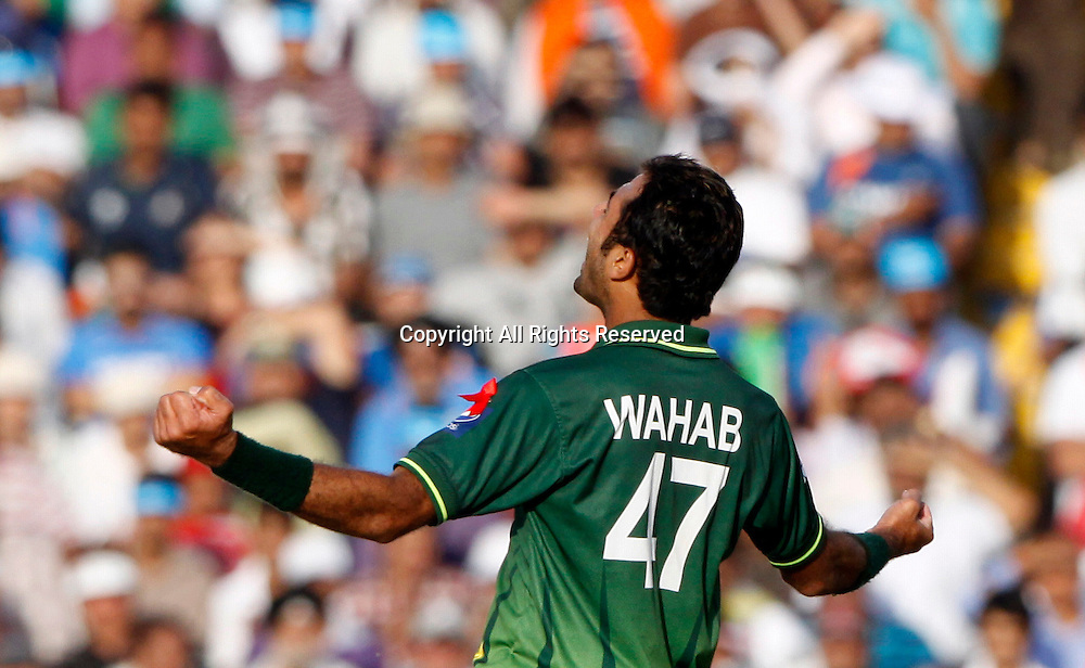 30.03.2011 Cricket World Cup from the Punjab Cricket Association Stadium, Mohali in Chandigarh. India v Pakistan. Wahab Riaz of Pakistan celebrates the wicket of Indian Captain Mahendra Singh Dhoni during the match of the ICC Cricket World Cup between India and Pakistan on the 30th March 2011