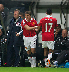 NEWCASTLE, ENGLAND - Tuesday, April 19, 2011: Manchester United's substitute Michael Owen, a former Newcastle United player, replaces Nani during the Premiership match at St James' Park. (Photo by David Rawcliffe/Propaganda)