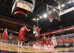 Virginia guard Sean Singletary (44) leaps past Maryland forward Jerome Burney (32) towards the hoop.  The Virginia Cavaliers defeated the Maryland Terrapins 91-76 at the University of Virginia's John Paul Jones Arena  in Charlottesville, VA on March 9, 2008.