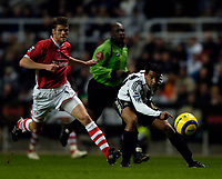 Photo: Jed Wee.<br /> Newcastle United v Charlton Athletic. The Barclays Premiership. 22/02/2006.<br /> <br /> Newcastle's Nolberto Solano (R) tries to get a shot in on goal as Charlton's Hermann Hreidarrson.