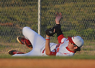 Lafayette High's Hunter Bishop (4) makes a sliding catch vs. Corinth in MHSAA Class 4A playoff action in Oxford, Miss. on Saturday, May 3, 2014.
