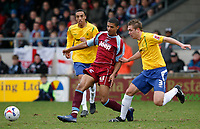Photo: Steve Bond.<br />Scunthorpe United v Nottingham Forest. Coca Cola League 1. 10/03/2007. Jermaine Beckford (left) attacks as Forest defender Luke Chambers closes in (right)