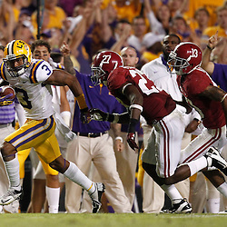 November 3, 2012; Baton Rouge, LA, USA;  LSU Tigers wide receiver Odell Beckham (3) runs away from Alabama Crimson Tide defensive back Nick Perry (27) during a game at Tiger Stadium. Alabama defeated LSU 21-17. Mandatory Credit: Derick E. Hingle-US PRESSWIRE