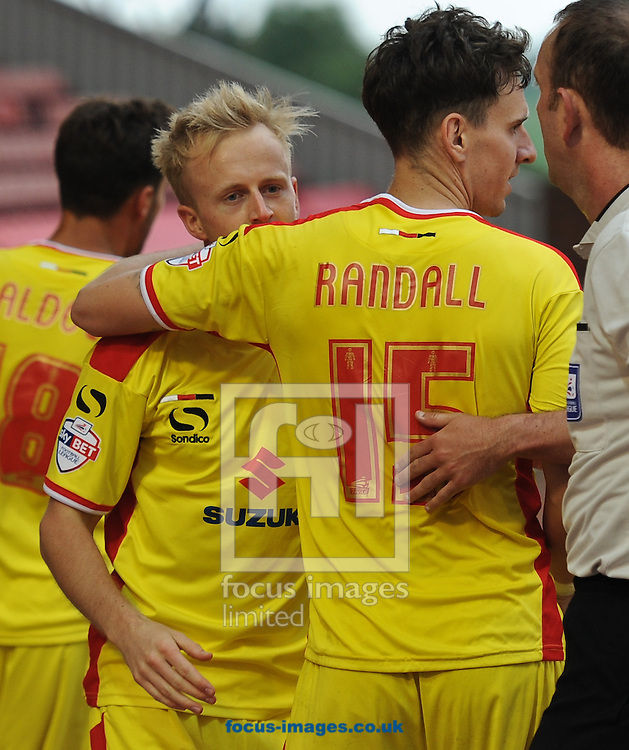 Ben Reeves (facing) of Milton Keynes Dons celebrates scoring to amke it 5-0 during the Sky Bet League 1 match at Oakwell, Barnsley<br /> Picture by Richard Land/Focus Images Ltd +44 7713 507003<br /> 13/09/2014