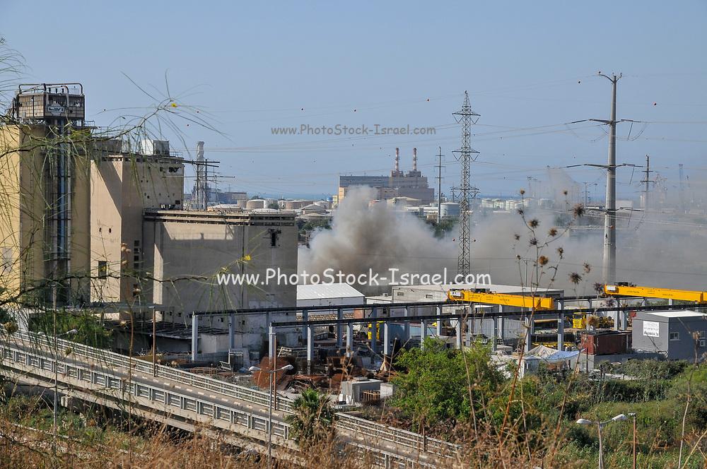 Heavy smoke is seen from a fire in the Haifa recycling facility. Haifa Bay, Israel