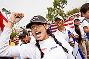 10 APRIL 2006 - PHOENIX, AZ: Immigrants chant at a rally in Phoenix, Monday. More than 200,000 people participated in a march for immigrants's rights in Phoenix Monday. The march was a part of a national day of action on behalf of undocumented immigrants. There were more than 100 such demonstrations across the US Monday. Protestors were encouraged to wear white, to symbolize peace, and wave American flags, to demonstrate their patriotism to the US.  Photo by Jack Kurtz