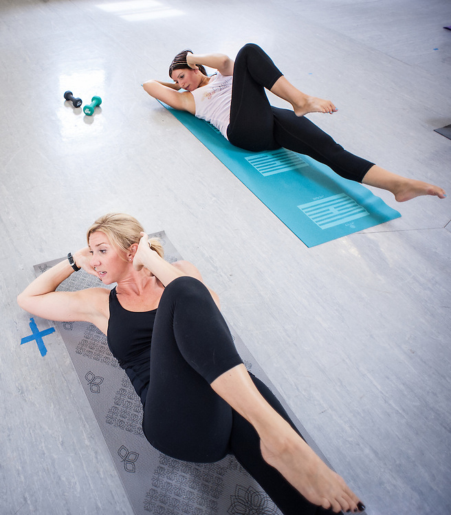 COLUMBIA, MD -- 7/22/13 -- Rachel Gribben leads her Barre Fusion class with student Sara Emden, of Columbia….. by André Chung #AC2_9357