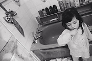 Liitle girl brushing her teeth in the bathroom Newport South Wales