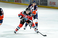 KELOWNA, CANADA, OCTOBER 29: Zach Franko #9 of the Kelowna Rockets is checked by Chase Schaber #10 of the Kamloops Blazers as the Kamloops Blazers visit the Kelowna Rockets  on October 29, 2011 at Prospera Place in Kelowna, British Columbia, Canada (Photo by Marissa Baecker/Shoot the Breeze) *** Local Caption *** Zach Franko; Chase Schaber;