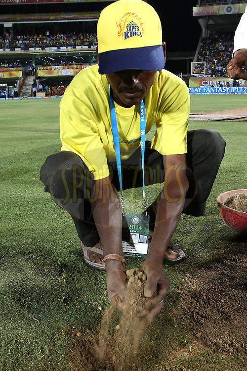 Ground staff dry the field after rain delayed the start during match 21 of the Pepsi Indian Premier League Season 2014 between the Chennai Superkings and the Kolkata Knight Riders  held at the JSCA International Cricket Stadium, Ranch, India on the 2nd May  2014<br /> <br /> Photo by Shaun Roy / IPL / SPORTZPICS<br /> <br /> <br /> <br /> Image use subject to terms and conditions which can be found here:  http://sportzpics.photoshelter.com/gallery/Pepsi-IPL-Image-terms-and-conditions/G00004VW1IVJ.gB0/C0000TScjhBM6ikg