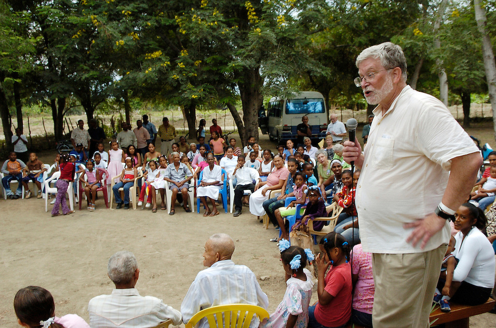 Fr. Bob Stiefvater addresses parishioners outside of the church at Proyecto 4, site of the first church at La Sagrada Familia. The home church has since been relocated to Sabana Yegua. Fr. Stiefvater served in the Dominican Republic from 1981 to 1985.