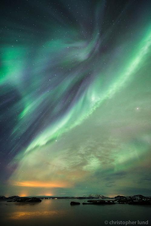 Northern Lights - Aurora Borealis over Lake Þingvallavatn. Looking east over Klumba and Island Nesjaey. South Iceland.