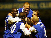 Fotball<br /> England 2004/2005<br /> 18.12.2004<br /> Foto: SBI/Digitalsport<br /> NORWAY ONLY<br /> <br /> Gillingham v Rotherham United<br /> Coca Cola Championship. 18/12/2004<br /> <br /> Gillingham players mob Chris Hope after he put his team 1-0 up.