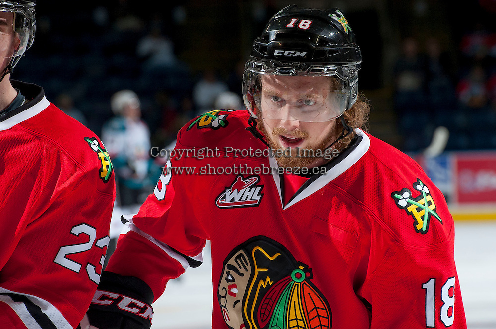 KELOWNA, CANADA - APRIL 25: Garrett Haar #18 of the Portland Winterhawks warms up against the Kelowna Rockets on April 25, 2014 during Game 5 of the third round of WHL Playoffs at Prospera Place in Kelowna, British Columbia, Canada. The Portland Winterhawks won 7 - 3 and took the Western Conference Championship for the fourth year in a row earning them a place in the WHL final.  (Photo by Marissa Baecker/Getty Images)  *** Local Caption *** Garrett Haar;
