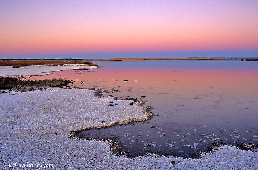 Twlight reflects in pond at Bowdoin NWR near Malta, Montana, USA