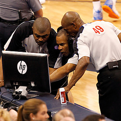 Jun 14, 2012; Oklahoma City, OK, USA; NBA officials review a play between the Oklahoma City Thunder and the Miami Heat during the fourth quarter of game two in the 2012 NBA Finals at Chesapeake Energy Arena. Miami won 100-96. Mandatory Credit: Derick E. Hingle-US PRESSWIRE