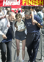 Caitriona MCKiernan gets some help at the finish line in Dublin's mini marathon (Copyright Independent News and Media)