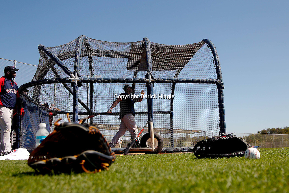 February 23, 2011; Fort Myers, FL, USA; Boston Red Sox left fielder Carl Crawford (13) takes batting practice during spring training at the Player Development Complex.  Mandatory Credit: Derick E. Hingle