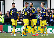 Oxford United players celebrate a goal during the FA Cup match between Merstham and Oxford United at Moatside, Merstham, United Kingdom on 5 November 2016. Photo by Andy Walter.