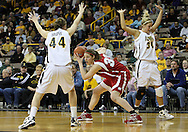 19 February 2009: Wisconsin forward Lin Zastrow (33) is defended by Iowa center Megan Skouby (44) and Iowa guard/forward Hannah Draxten (31) during the second half of an NCAA women's college basketball game Thursday, February 19, 2009, at Carver-Hawkeye Arena in Iowa City, Iowa. Iowa defeated Wisconsin 72-65.