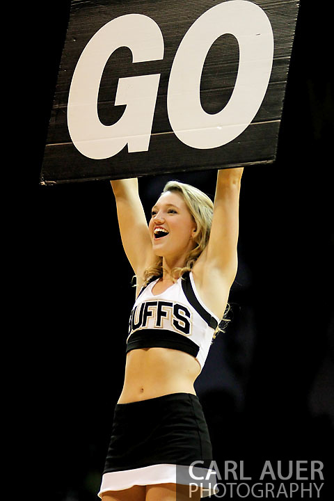 November 27, 2012: During a time out a cheerleader helps lead the Colorado crowd in a cheer during the NCAA Basketball game between the Texas Southern Tigers and the Colorado Buffaloes at the Coors Event Center in Boulder Colorado