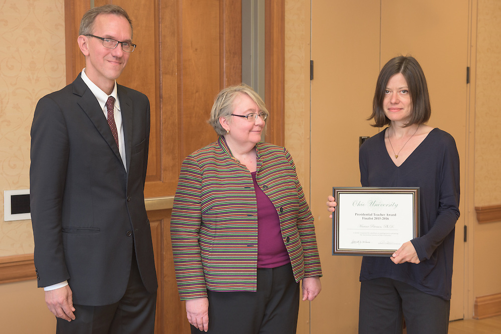 From left: Joseph Shields, Vice President for Research & Creative Activity and Dean of Ohio University's Graduate College along with Pam Benoit, Executive Vice President and Provost, congratulate Marina Peterson for being a finalist for the Presidential Teacher Award during the 2016 Faculty Awards Recognition Ceremony held at Baker Center on Tuesday, September 6, 2016.