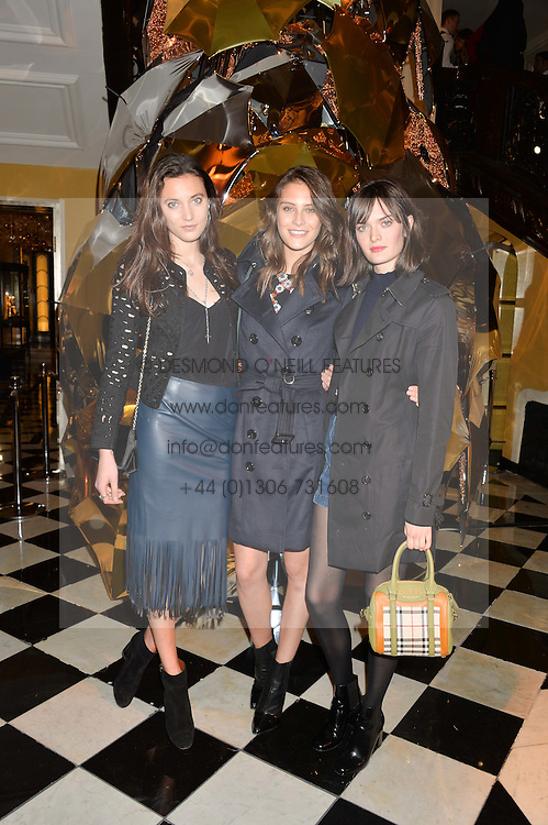 Left to right, MATILDA LOWTHER, CHARLOTTE WIGGINS and SAM ROLLINSON at a party to celebrate theunveiling of the Claridge's Christmas Tree designed by Christopher Bailey for Burberryheld at Claridge's, Brook Street, London on 18th November 2015.