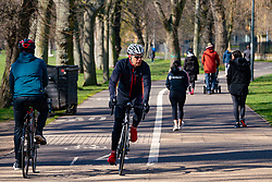 Edinburgh, Scotland, UK. 29 March, 2020. Life in Edinburgh on the first Sunday of the Coronavirus lockdown. Streets deserted, shops and restaurants closed, very little traffic on streets and reduced public transport. Pictured; People and families still outdoors exercising on The Meadows.  Iain Masterton/Alamy Live News