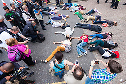 "London, July 5th 2014. Demonstrator hold a ""die-in"" as hundreds protest near the Israeli embassy in London against the ongoing occupation and the west's support of Israel's collective punishment of Palestinians"