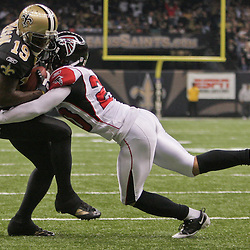 2009 November 02: Atlanta Falcons cornerback Brent Grimes (20) hits New Orleans Saints wide receiver Devery Henderson (19) after a catch during a 35-27 win by the Saints over the Falcons at the Louisiana Superdome in New Orleans, Louisiana.