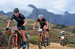 PAARL SOUTH AFRICA - MARCH 23: Kristian Hynek ahead of Damiano Ferraro on the 70km final day, stage 7 on March 23, 2018 Wellingtion to Paarl, South Africa. Mountain bikers gather from around the world to compete in the 2018 ABSA Cape Epic, racing 8 days and 658km across the Western Cape with an accumulated 13 530m of climbing ascent, often referred to as the 'untamed race' the Cape Epic is said to be the toughest mountain bike event in the world. (Photo by Dino Lloyd)