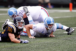 Sept 27, 2009; East Rutherford, NJ, USA; Tennessee Titans quarterback Kerry Collins (5) watches his pass fall incomplete after being hit by New York Jets safety Jim Leonhard (36) during the first half at Giants Stadium.