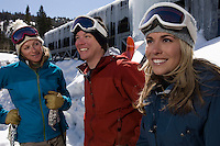 Three Skiers at Ski Resort